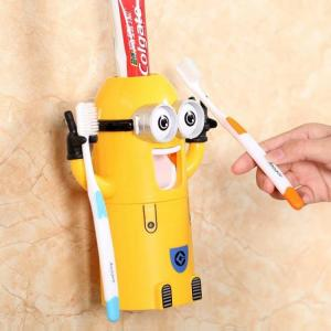 Minion automatic toothpaste dispenser and toothbrush holder